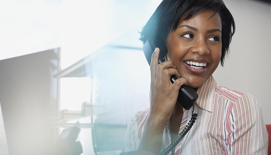 DFIR page: woman, in an office setting, on the phone
