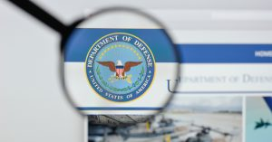 DoD: Department of Defense logo being looked through a magnifying glass