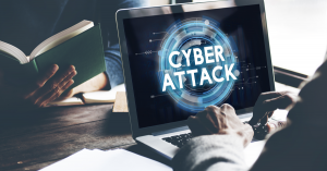 """A computer monitor with the words """"Cyber Attack"""" written on the screen."""